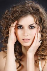 Closeup studio portrait of beautiful girl