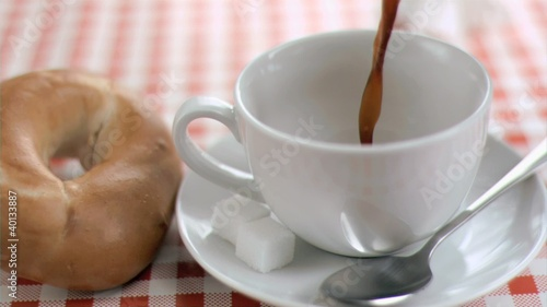 Coffee filling a cup in super slow motion