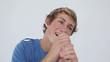 Happy young man playing karaoke