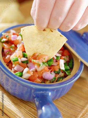 bowl of salsa with tortilla chips.
