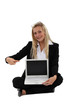 Blond businesswoman sat pointing at laptop