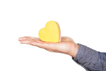 The shape of heart on the palm. On a white background.