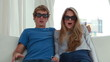 Cheerful couple wearing 3D glasses while playing together