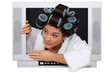 Woman wearing hair rollers escaping from television
