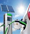 Leinwandbild Motiv E-Car an Solartankstelle mit Solarpanel