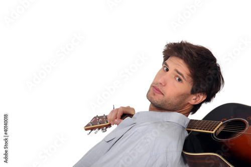 A man with an acoustic guitar.