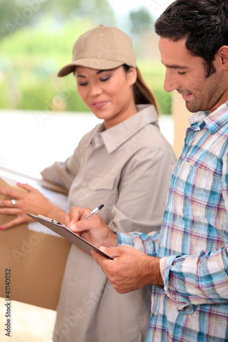 Man signing for the delivery of a parcel