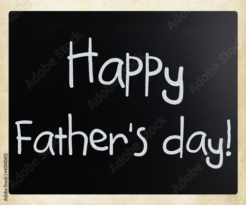 """Happy father's day"" handwritten with white chalk on a blackboar"