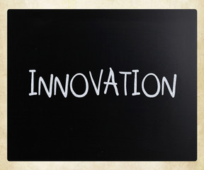 """Innovation"" handwritten with white chalk on a blackboard"
