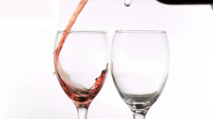 Wine and water poured in super slow motion