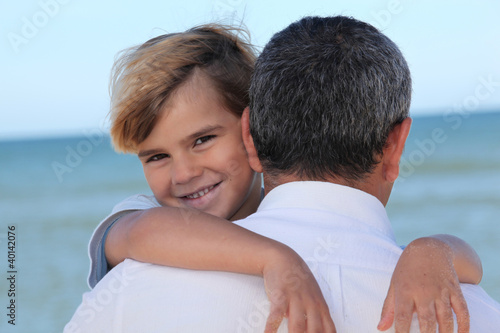 Child hugging his father