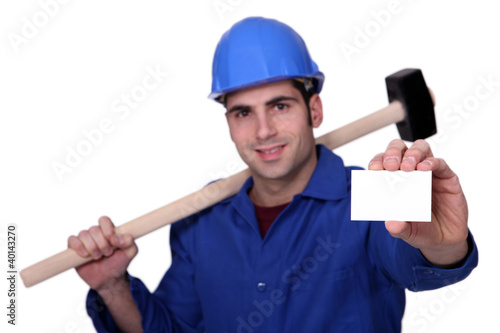 Craftsman with hammer and card