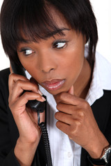 Concerned businesswoman taking phone call