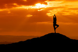 Fototapety Silhouette of a beautiful Yoga woman in the morning