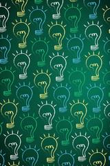 Many ideas with chalk drawn light bulbs on a blackboard.