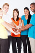 group of young multiracial people hands together