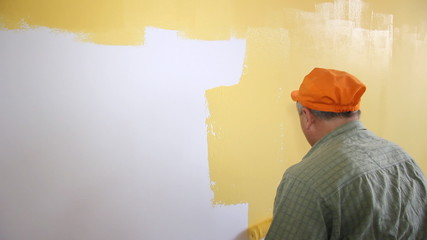 Painter in action, interior decoration