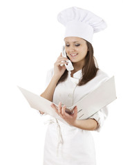 female cook with binder speaking on the phone