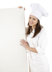 woman chef, baker or cook smiling holding blank sign