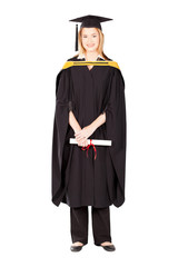 pretty female college graduate in gown and cap on white
