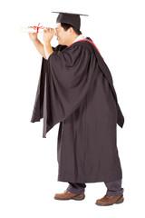 male university graduate looking through certificate