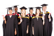 group of multiracial graduates on white