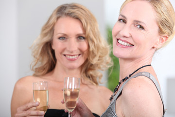 Two women with champagne flutes