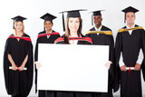 attractive graduate holding white board with classmates