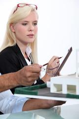 Blonde woman taking notes