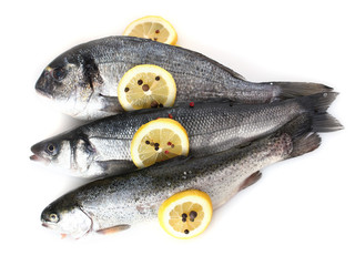 Fresh fishes with lemon and pepper isolated on white