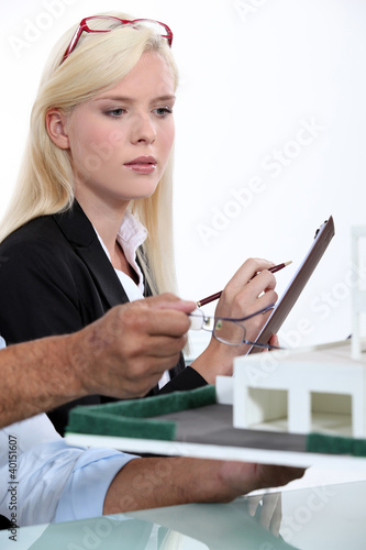 Blonde woman taking notes