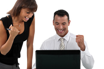 Young business couple at a laptop