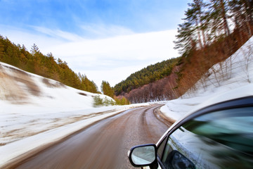 car moves along the winding roads of winter.