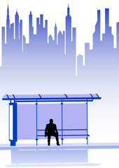 Man on bus stop in city