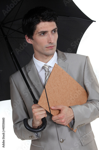 Man with umbrella and folder under his arm