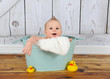 sweet baby boy playing in washtub
