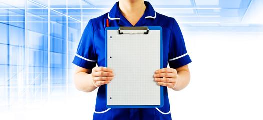 staff nurse holding clipboard