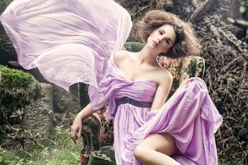 Glamorous woman wearing beautiful dress