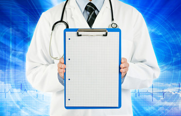 physician holding graph paper