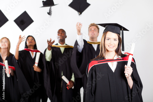 university graduate at graduation with classmates