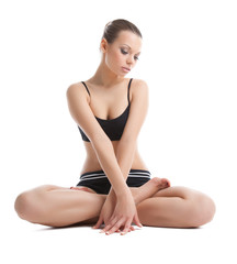 Beautiful young woman sit in lotos yoga pose