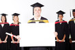happy male graduate holding white board