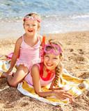 Fototapety Children playing on  beach.