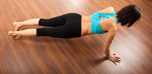 Fitness woman makes press ups