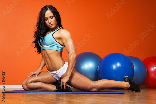 Brunette is doing exercises