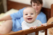 Happy baby in cot