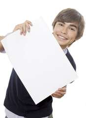 The young man holds a paper blank leaf