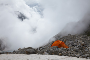 Orange tent in a high mountains