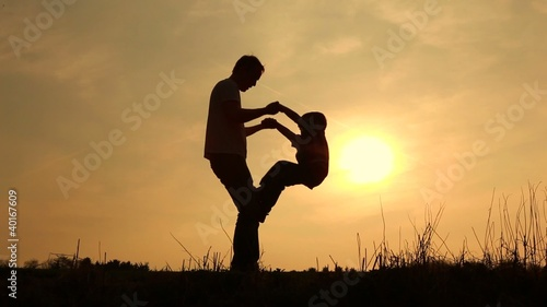 a boy climbing on his father