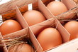Eggs with a straw in a wooden basket